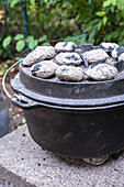 Dutch oven with charcoal