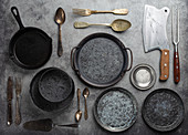 Old vintage tableware and kitchen utensils on rustic stone background