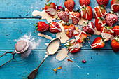 Strawberries and cream topped with icing sugar and edible petals