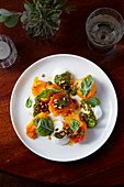 Roasted squash with goat's curd and lovage pesto
