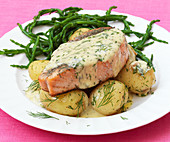 Roasted salmon with new potatoes and salicornes