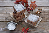Autumnal vegan chestnut and almond cake with icing sugar