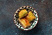 Baklava - traditional Turkish dessert pastry made of filo layers with chopped nuts and syrup