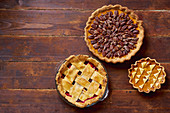 Variety of thanksgiving pies on wooden table