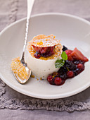 Milk pudding with berry compote