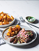 Coffee-rubbed steak with crispy potatoes