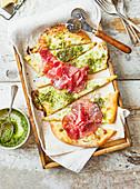 Mozzarella and pesto pizza with bresaola
