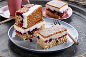 Cake with cream, cherries and a sesame-caramel layer