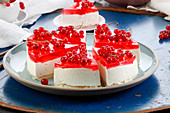 Creamy cold cake with redcurrant jelly