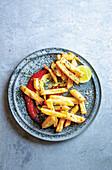 Potato fries with tomato sauce
