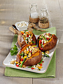 Baked sweet potatoes filled with chicken breast and feta cheese