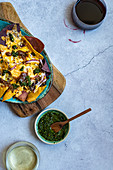 Nachos with coriander chutney, cheese, black beans and tempered spices