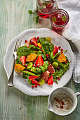 Fruit salad with baby spinach and yogurt