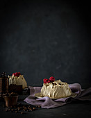 Small cream pies with raspberries