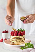 Pancakes with raspberries and passion fruit
