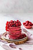 Red pancakes with berries
