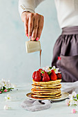 Pancakes with fresh strawberries and syrup