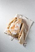 Spelt bread in a linen bag
