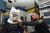 Paramedics testing fit of face mask