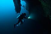 Scuba divers inside the Great Blue Hole, Belize