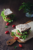 Sandwich with chickpea burger, lettuce and tomato