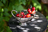 Fresh cherries in a gravy boat