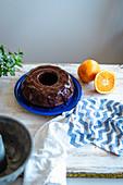 Chocolate bundt cake with coconut sugar and orange chocolate glaze