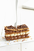 A millefeuille with dark and white chocolate cream