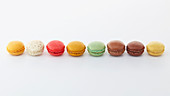 Colorful macaron cookies arranged in shape of emoji smile