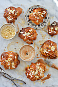 Cinnamon rolls with almonds and frosting