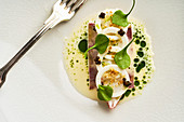 Veal head with langoustine and herb espuma