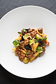 A pasta dish with a wild boar sauce, black chanterelle and Brussels sprouts