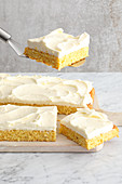 A carrot cake tray bake with frosting