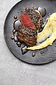 French pepper steak with mashed potatoes
