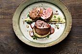 Festive venison steaks with herb polenta