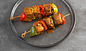 Spicy pork skewers with peppers and Mexican spices