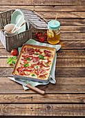 Savory pie with mozzarella, tomatoes and dried ham