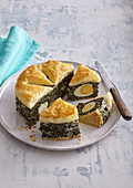 Spinach pie with boiled eggs
