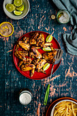Chicken wings with lime, beer and fries