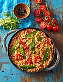 Vegetarian tomato paella with mangetout
