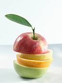 A stack of apple and citrus fruit slices