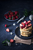 Stack of waffles with fresh strawberries