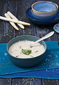 Cream of white asparagus soup with garden cress