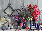 An arrangement of scented plants – roses, lavender, sweet peas, jasmine and carnations