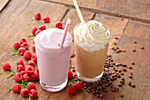 A strawberry milkshake and a coffee milkshake
