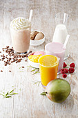 A coffee milkshake, a strawberry milkshake and a mango slush