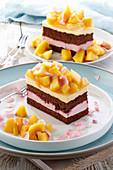 Chocolate cake with mango and cherry cream