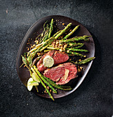 Entrecôte with fried asparagus and blue cheese butter