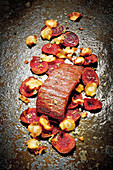 Grilled flank steak with vegetable chips and lime salt