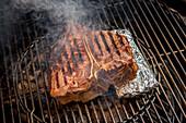 Porterhouse steak on a grill rack